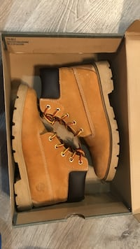 pair of brown Timberland work boots in box
