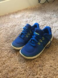 pair of blue-and-white Nike running shoes 25 km
