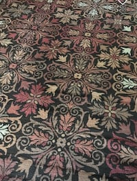 8x10 rug. In great shape but did not fit in to our moving box. Must sell by Friday! Color brown. Jacksonville, 32207