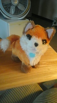 brown and white fox plush toy