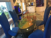 Round clear glass-top table with chairs and with buffet and desk North Bellmore, 11710