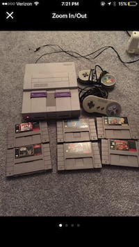 gray Super Nintendo console with six game cartridges Delaware, 18328