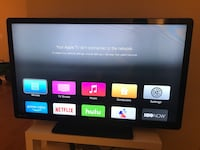 black flat screen TV with remote Los Angeles, 90048