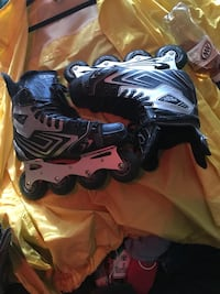pair of black-and-gray inline skates 151 mi