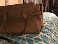 Coach purse, very good condition. Color is beige South Windsor, 06074