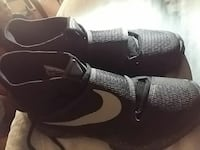 pair of black Nike athletic shoes