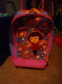 A Dora the Explorer suitcase Rocky Point, 28457