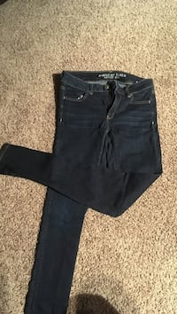 black denim jeans and black shorts