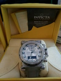 round silver Invicta chronograph watch with link b