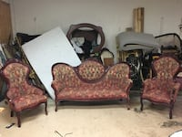 two brown wooden framed red padded armchairs Houston, 77080