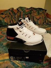 white-and-black Air Jordan basketball shoes with black box
