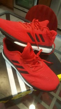 pair of red Adidas running shoes Chicago, 60641