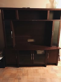 black wooden TV hutch with flat screen television Toronto, M9C 4W9