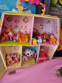 pink and green plastic dollhouse Alexandria