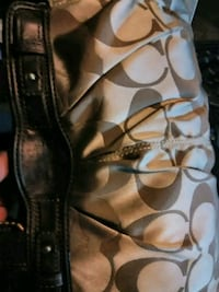 brown and white Coach leather shoulder bag