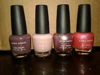 four assorted-color nail polish bottles