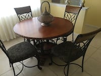 round brown wooden table with four chairs dining set Sarasota, 34240