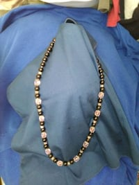 a glass black and pink beaded necklace Edmond, 73034