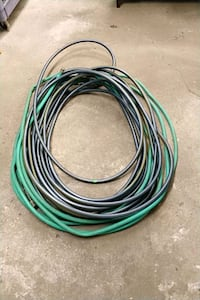Two garden hoses and misc connectors Glen Ellyn