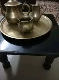 two brown ceramic candle holders