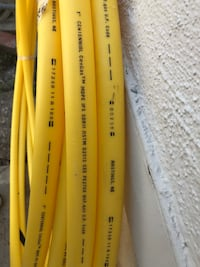 Yellow and black coated hose