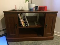 brown wooden TV stand with cabinet Laval, H7T 2M9