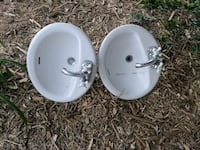 two oval white ceramic sinks 25.00 each