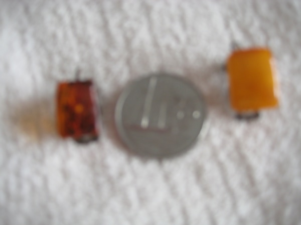 Clip on amber earings, color differ as some jewelry contains multiple colors of amber.