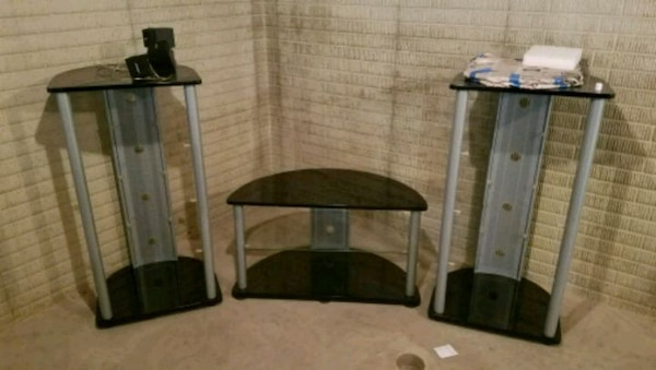Black/metal TV stand and media towers