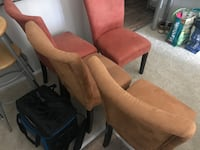 Suede chairs (2 sand colored, 2 orange colored) with wooden legs