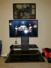 black flat screen TV and black wooden TV stand 17 mi