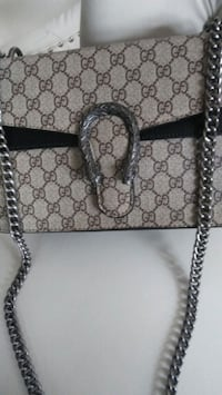 brown and black monogrammed Gucci leather handbag