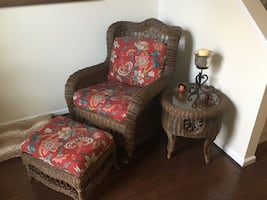 Wicker chair, footstool, and table.
