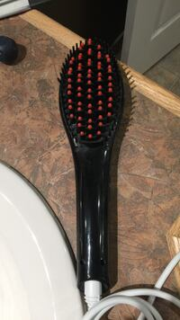 Black electric hair brush Southwold, N5P 4L5
