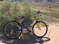 Blue and yellow hardtail bicycle