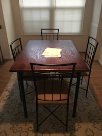Wooden kitchen table with 4 chairs and rug Centreville