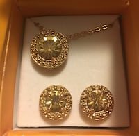 gold-colored necklace and earrings set