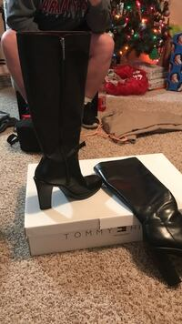 pair of black Tommy Hilfiger leather side-zip ankle-strap pump-heeled knee-high boots with box