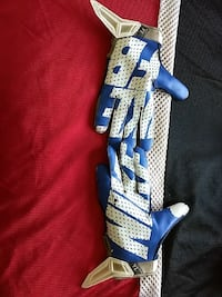 pair of blue-and-white Nike leather gloves