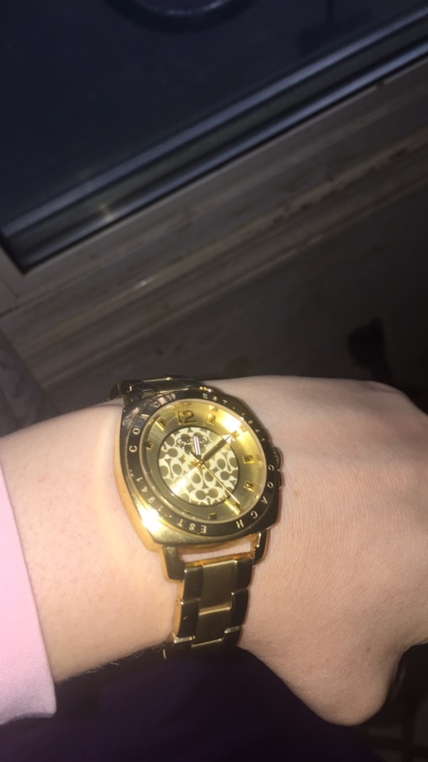 round gold-colored chronograph watch with link bracelet
