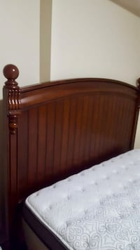 Brown wooden bed headboard and footboard Toronto, M5G 2C4
