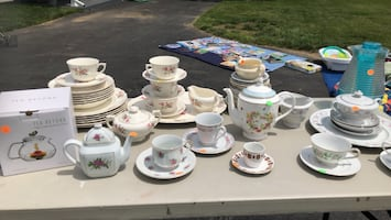 Tea set. All the tea cups are together.