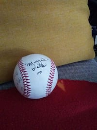 white and red baseball with signatures from 4 of t Denver, 80210
