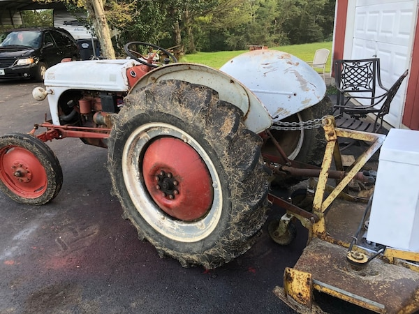 8 n tractor with woods finish mower lots of new parts needs paint otherwise  good ole tractor
