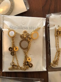 Gold-colored chain link necklace and bracelets  pack Edmonton, T5H 3E9