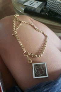 gold chain with charm . Oakville, L6H 2K3