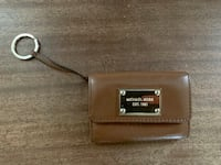 Michael Kors small wallet with key chain. Genuine saddle brown leather. In very good condition Potomac, 20854