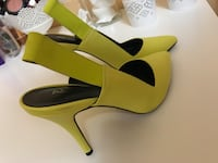 pair of yellow-and-black leather sandals Montréal, H3S 1M9