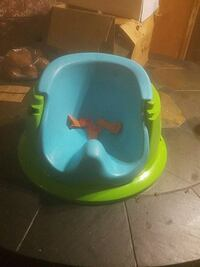 baby's blue and green booster seat Spring Hill, 34606