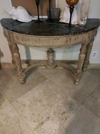 round brown wooden coffee table Palm Springs, 33461